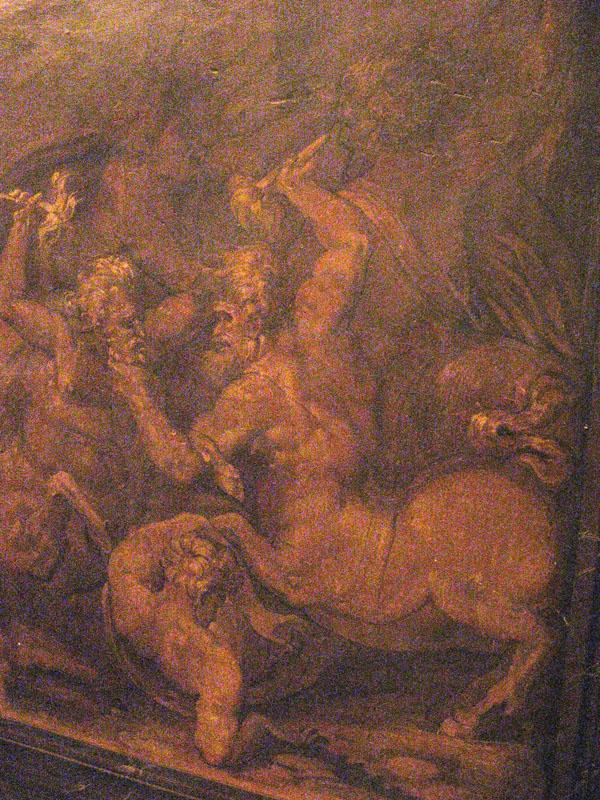 Fig. 15. Giorgio Vasari and assistants, A Centauromachy, 1555-57 Right Dado below Vulcan's Forge, Sala degli Elementi,  Palazzo Vecchio, Florence Photo credit: author
